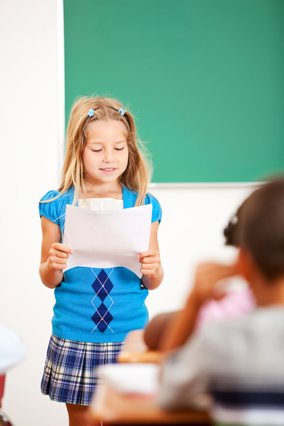 Child-presenting-with-notes